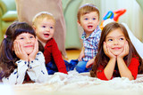 group of attentive kids in nursery room