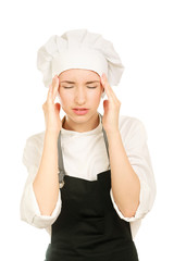 Young woman cook with head pain on white background
