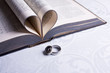 Two Hebrew wedding rings with a heart shaped Afrikaans Bible