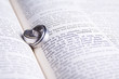 Two Hebrew wedding rings on an open Afrikaans Bible