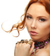 Beautiful attractive model with many multicolored jewelry