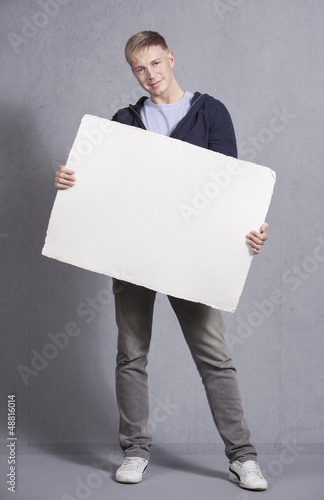 Friendly man showing white blank panel.
