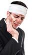 Sad injured business man, isolated on white