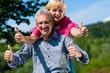 happy mature or senior couple having walk