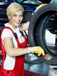 Female apprentice preparing a tire