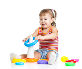 little child playing with colorful toys, isolated over white