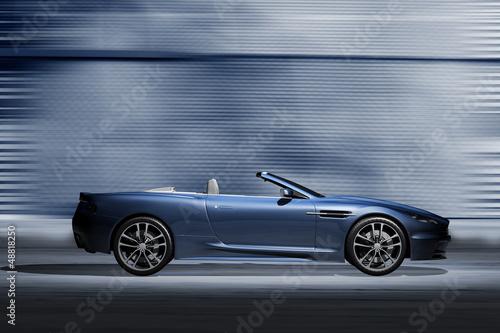 canvas print picture Offener Sportwagen vor futuristischer Kulisse