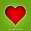 Abstract red heart on green paper background. Valentines day gre