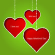 Abstract red hearts on green paper background. Valentines day gr