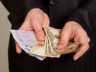 businessman in a suit holding a money