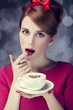 Redhead girl with cup of coffee for St. Valentine's Day.