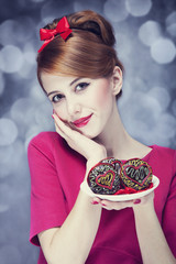Redhead girl with cake for St. Valentine Day.
