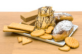 different confectionery products in a white plate poster