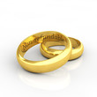 Golden wedding rings on white background with humorous engraving