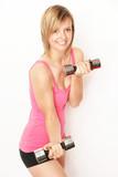 junge Fitnesslehrerin
