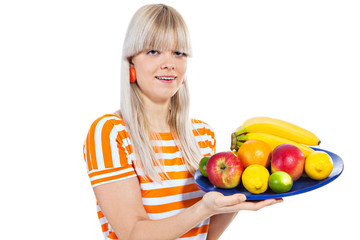Beautiful girl holding plate with fresh fruit