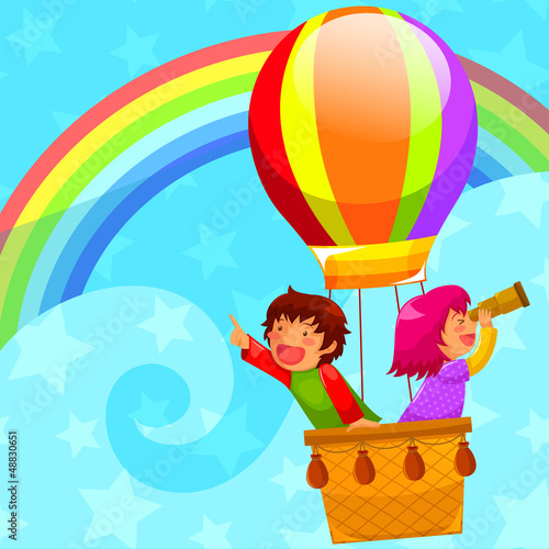 Keuken foto achterwand Regenboog kids flying in a hot air balloon