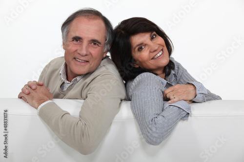 Adult couple stood with blank advertising panel