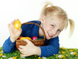 Cute blonde child is happy to find her Easter eggs