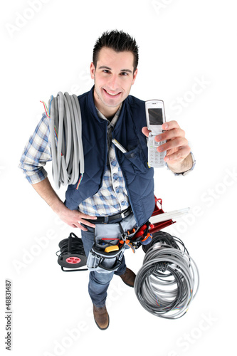 electrician with telephone and tools
