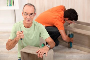 Father and son building furniture