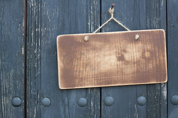 Grunge wood frame blank with rope hanging on nail background