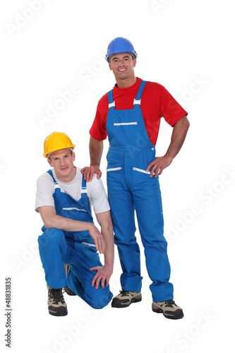A team of tradesmen posing for the camera