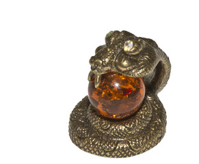 snake amber ball in his mouth on a white  background