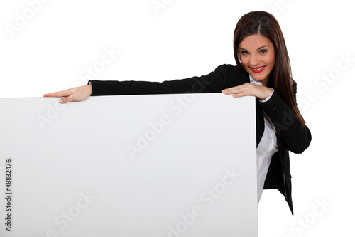 Attractive business woman with blank poster