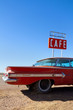 Cafe Sign and Old Car on Route 66 - 48833443