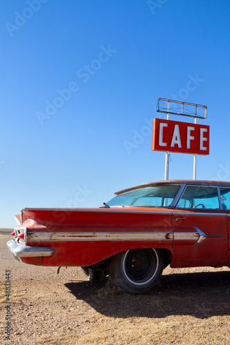 Cafe Sign and Old Car on Route 66 Poster