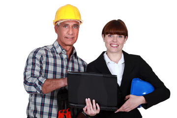 Architect and foreman stood with laptop