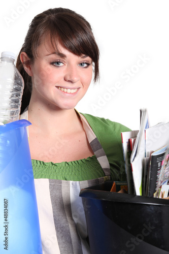 Girl sorting her garbage