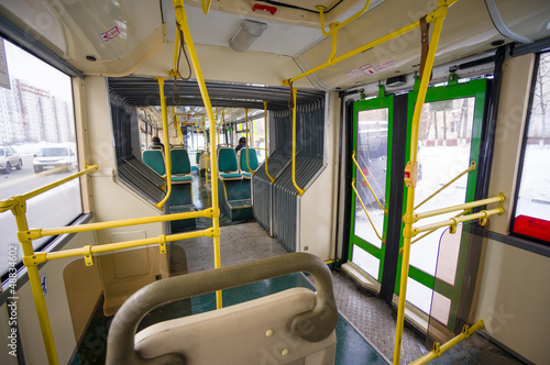 Interior of modern city articulated bus. Articulated joint and d