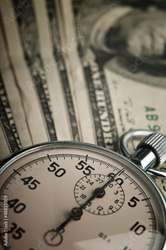 dollars bills and stopwatch