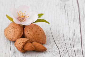 almonds on wooden background white