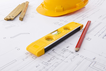 Hard hat and tools on a blueprint