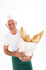 Baker holding bag of bread