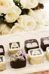 Small chocolates decorated for wedding party.
