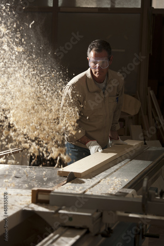 Carpenter working in workshop
