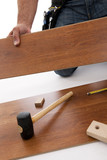 Carpenter working with wood planks