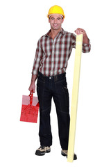 Confident carpenter standing on white background
