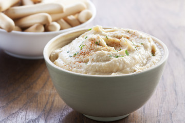 Chickpea hummus bowl with bread sticks