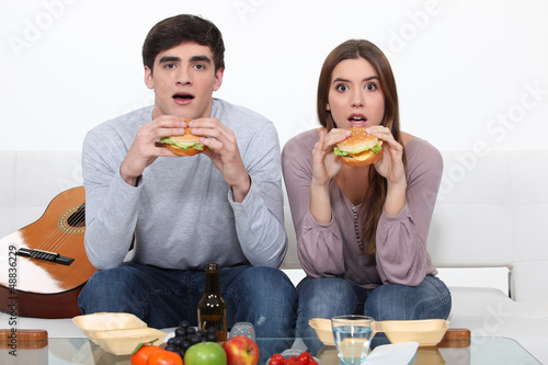 Two students eating burgers