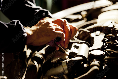 Automobile mechanic working in garage