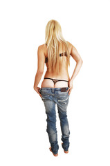 Woman taking jeans off.