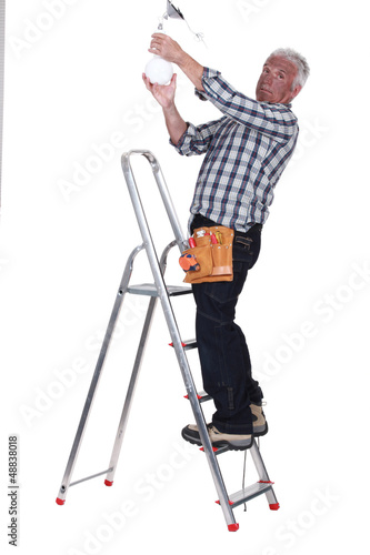 electrician fixing a bulb
