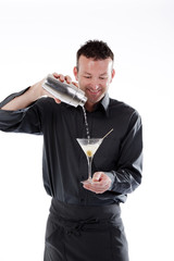 Bartender pouring cocktail in glass