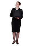 Pensive businesswoman stood with laptop