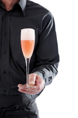 Server holding cocktail glass